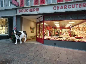 a cow at the butcher